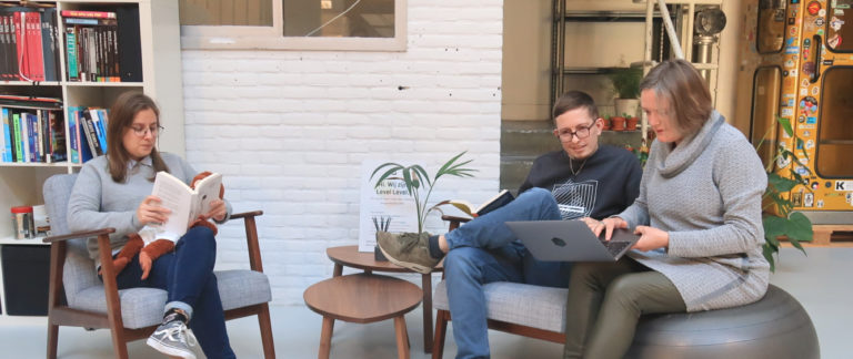 Marlou, Ken & Rian discussing their work